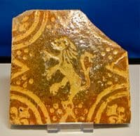 A large and attractive 16th Century glazed floor tile featuring a rampant Lion. SOLD