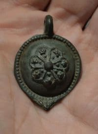 A large and superb quality Tudor period bronze domed decorative pendant, British. SOLD