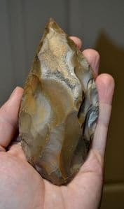 A large, stunning and beautifully worked Upper Paleolithic flint hand axe, Dordoigne, France SOLD