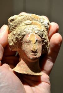 A large, superb and well detailed Ancient Greek solid terracotta head of a female from a large statuette, Corinthian. SOLD