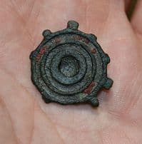 A Roman bronze circular plate brooch with traces of original red enamelling, Yorkshire. SOLD