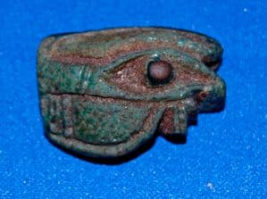 A very large Ancient Egyptian green glazed Eye of Horus amulet. SOLD