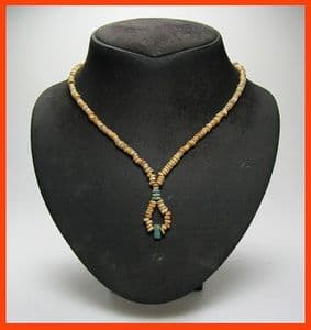 An attractive restrung necklace of Ancient Egyptian multicoloured Faience beads, drop design at base containing amulet, modern twist clasp. SOLD