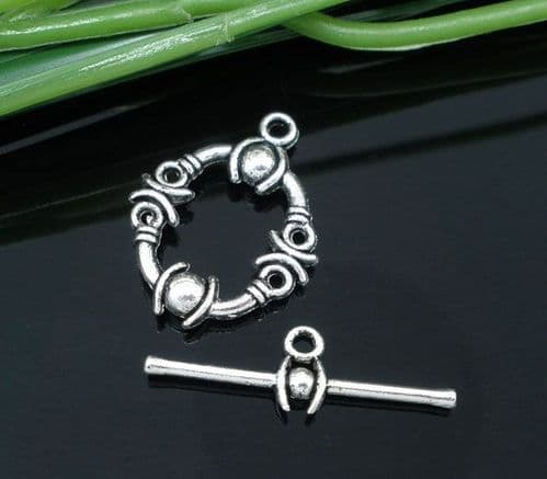 8 Round Antique Silver Carved Toggles